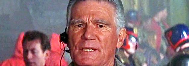 Vartis Hammond. Graue Eminenz von Mega-City Broadcasting Corporation. Und heimlicher Held in Judge Dredd (1995)